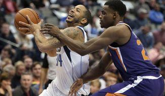 Dallas Mavericks guard Devin Harris (34) drives against Phoenix Suns forward Danuel House Jr. (23) during the first half of an NBA basketball game in Dallas, Monday, Dec. 18, 2017. (AP Photo/LM Otero)