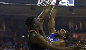 Texas center Mohamed Bamba, left, blocks the shot of Tennessee State forward Christian Mekowulu, right, during the first half of an NCAA college basketball game, Monday, Dec. 18, 2017, in Austin, Texas. (AP Photo/Michael Thomas)