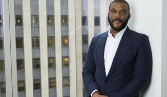 "In this Nov. 16, 2017 photo, actor-filmmaker and author Tyler Perry poses for a portrait in New York to promote his book, ""Higher Is Waiting."" (Photo by Amy Sussman/Invision/AP)"