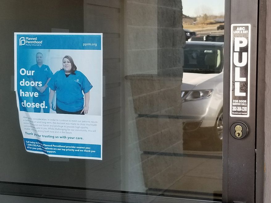 A sign taped to the window informs people of the closure of the Planned Parenthood clinic in Parker, Colorado. It was one of the 32 Planned Parenthood centers that shut down this year, according to a study. (Bradford Richardson/The Washington Times)