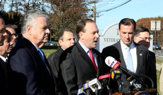 Republican Reps. Peter King, left, and Lee Zeldin, center, join Democratic Rep. Tom Suozzi, right, at a press conference with local elected officials and business leaders, Tuesday, Nov. 28, 2017, in Hauppauge, N.Y. (AP Photo/Frank Eltman) ** FILE **