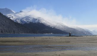 Strong winds whip around fresh snow on the mountains on Friday, March 3, 2017, in Juneau, Alaska. (AP Photo/Becky Bohrer)