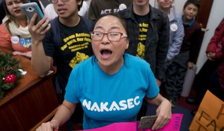 Activists protested this week in the offices of Senate Minority Leader Charles E. Schumer, New York Democrat, to demand a clean Dream Act. (Associated Press)