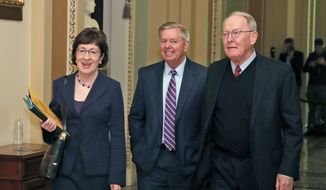 Sen. Susan Collins, R-Maine, left, Sen. Lindsey Graham, R-S.C., and Sen. Lamar Alexander, R-Tenn., walk to the Republican policy luncheon on Capitol Hill, Tuesday, Dec. 19, 2017 in Washington. (AP Photo/Alex Brandon)