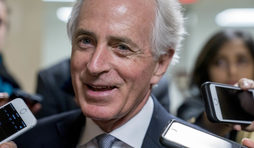 Sen. Bob Corker, R-Tenn., speaks to reporters as Congress prepares to vote on the biggest reshaping of the U.S. tax code in three decades, on Capitol Hill, Tuesday, Dec. 19, 2017, in Washington. (AP Photo/Andrew Harnik)