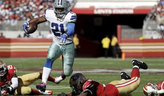 FILE - In this Oct. 22, 2017, file photo, Dallas Cowboys running back Ezekiel Elliott (21) runs against the San Francisco 49ers during the first half of an NFL football game in Santa Clara, Calif. Elliott gets back in a football routine after missing six games for the Cowboys when the star running back was suspended over domestic violence allegations. (AP Photo/Marcio Jose Sanchez, File)