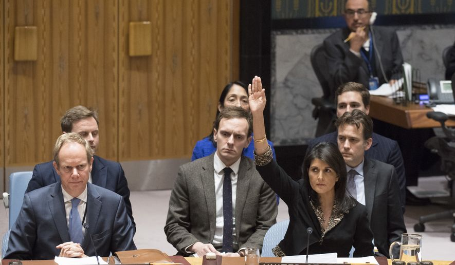 In this Monday, Dec. 18, 2017, photo, U.S. Ambassador to the United Nations Nikki Haley, right, votes against a resolution concerning Jerusalem's status at U.N. headquarters (Eskinder Debebe/UN Photo via AP)
