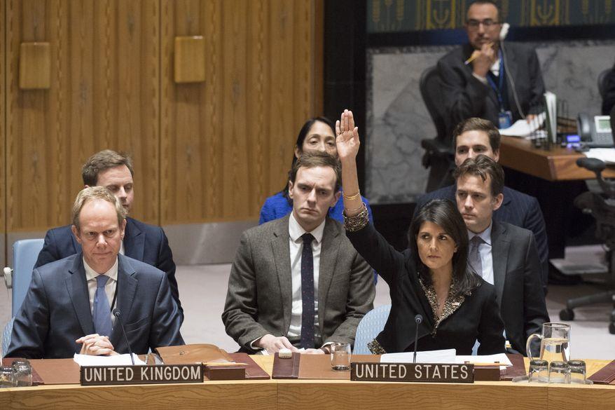In this Monday, Dec. 18, 2017, photo, U.S. Ambassador to the United Nations Nikki Haley, right, votes against a resolution concerning Jerusalem's status at U.N. headquarters (Eskinder Debebe/UN Photo via AP)