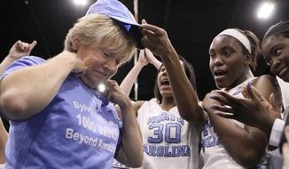 North Carolina coach Sylvia Hatchell is greeted by her players after their 79-63 win over Grambling State in an NCAA college basketball game in the Crescom Bank Holiday Invitational tournament, Tuesday, Dec. 19, 2017, at the Myrtle Beach Convention Center in Myrtle Beach, S.C. Hatchell, who battled leukemia and was declared cancer-free in 2014, earned her 1,00th career coaching victory with the win. (Janet Blackmon Morgan/The Sun News via AP)