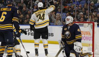 Boston Bruins forward Jake DeBrusk (74) scores on Buffalo Sabres Goalie Robin Lehner (40) during the second period of an NHL hockey game, Tuesday, Dec. 19, 2017, in Buffalo, N.Y. (AP Photo/Jeffrey T. Barnes)