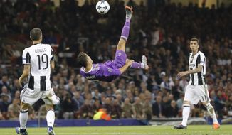 FILE - In this Saturday June 3, 2017 file photo Real Madrid's Cristiano Ronaldo connects with an overhead kick during the Champions League final soccer match between Juventus and Real Madrid at the Millennium stadium in Cardiff, Wales. (AP Photo/Frank Augstein, File)