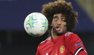 FILE - Manchester United's Marouane Fellaini heads the ball during the UEFA Super Cup final soccer match between Real Madrid and Manchester United at Philip II Arena in Skopje, on Aug. 8, 2017. (AP Photo/Boris Grdanoski)