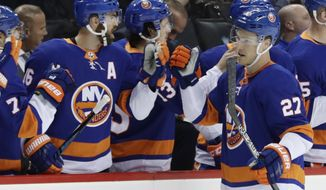New York Islanders' Anders Lee (27) celebrates with teammates after scoring a goal during the first period of an NHL hockey game against the Detroit Red Wings, Tuesday, Dec. 19, 2017, in New York. (AP Photo/Frank Franklin II)