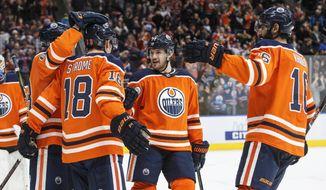 Edmonton Oilers' Ryan Strome (18), Matthew Benning (83), Oscar Klefbom (77) and Jujhar Khaira (16) celebrate a goal against the San Jose Sharks during the third period of an NHL hockey game in Edmonton, Alberta, Monday, Dec. 18, 2017. (Jason Franson/The Canadian Press via AP)