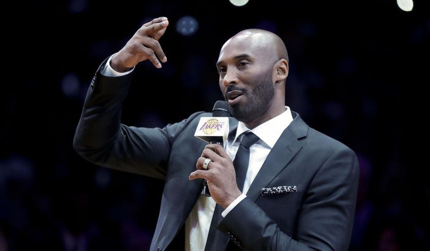 Former Los Angeles Laker Kobe Bryant speaks during a halftime ceremony retiring both of his jersey's during an NBA basketball game between the Los Angeles Lakers and the Golden State Warriors, in Los Angeles, Monday, Dec. 18, 2017. (AP Photo/Chris Carlson) ** FILE **
