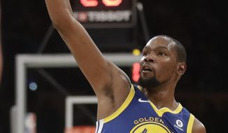 Golden State Warriors forward Kevin Durant celebrates a basket against the Los Angeles Lakers during the first half of an NBA basketball game in Los Angeles, Monday, Dec. 18, 2017. (AP Photo/Chris Carlson)