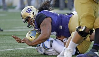 In this Oct. 28, 2017, file photo, Washington's Vita Vea sacks UCLA quarterback Josh Rosen in the first half of an NCAA college football game, in Seattle. Vea's impact on the game was enough that coaches voted the Washington defensive tackle the Pac-12 defensive player of the year. He's got likely one more game for the Huskies in the Fiesta Bowl against Penn State. (AP Photo/Elaine Thompson) ** FILE **