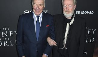 "Christopher Plummer, left, and director Ridley Scott arrive at the world premiere of ""All the Money in the World"" at the Samuel Goldwyn Theater on Monday, Dec. 18, 2017, in Beverly Hills, Calif. (Photo by Jordan Strauss/Invision/AP)"