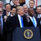 President Trump held a jubilant rally at the White House on Wednesday for congressional Republicans after they passed a $1.5 trillion tax overhaul bill, delivering on a central campaign promise. (Associated Press)