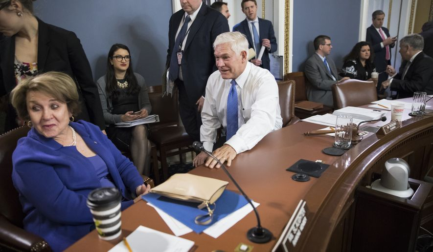 House Rules Committee Chairman Pete Sessions, R-Texas, center, with Rep. Louise Slaughter, D-N.Y., the ranking member, left, meet early Wednesday, Dec. 20, 2017, to approve some procedural corrections in the final version of the Republican tax bill, on Capitol Hill, in Washington. (AP Photo/J. Scott Applewhite)