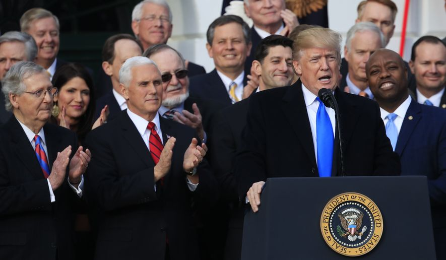 President Donald Trump, with, from left, Senate Majority Leader Mitch McConnell of Ky., Vice President Mike Pence, House Speaker Paul Ryan of Wis., and Sen. Tim Scott, R-S.C., speaks about the passage of the tax bill on the South Lawn at the White House in Washington, Wednesday, Dec. 20, 2017. (AP Photo/Manuel Balce Ceneta)