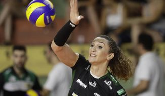 Bauru's volleyball player Tiffany Abreu spikes the ball during a Brazilian volleyball league match in Bauru, Brazil, Tuesday, Dec. 19, 2017. Tiffany Abreu is Brazil's first transgender person to play in the top volleyball league for women. (AP Photo/Andre Penner)