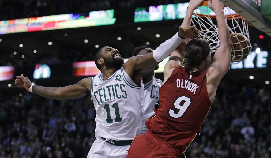 Miami Heat center Kelly Olynyk (9) beats Boston Celtics guard Kyrie Irving (11) to the basket for a dunk during the second half of an NBA basketball game in Boston, Wednesday, Dec. 20, 2017. The Heat won 90-89. (AP Photo/Charles Krupa)