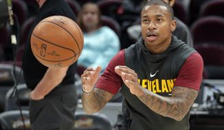 FILE - In this Nov. 22, 2017, file photo, Cleveland Cavaliers' Isaiah Thomas catches a pass before the team's NBA basketball game against the Brooklyn Nets in Cleveland. Cavaliers All-Star point guard Isaiah Thomas said he could return to the court as early as next week after being sidelined all season with a hip injury, Wednesday, Dec. 20, 2017.  (AP Photo/Tony Dejak, File)