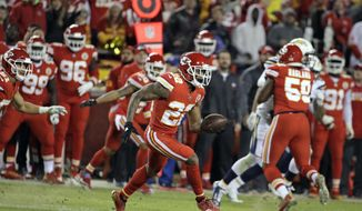 FILE - In this Dec. 16, 2017, file photo, Kansas City Chiefs defensive back Marcus Peters (22) runs for 62-yards after intercepting the ball during the second half of an NFL football game against the Kansas City Chiefs, in Kansas City, Mo. The mercurial nature of Chiefs cornerback Marcus Peters was on full display Sunday, when the same young star who was suspended for a series of embarrassing incidents came up big in a win over the Chargers. (AP Photo/Charlie Riedel, File)