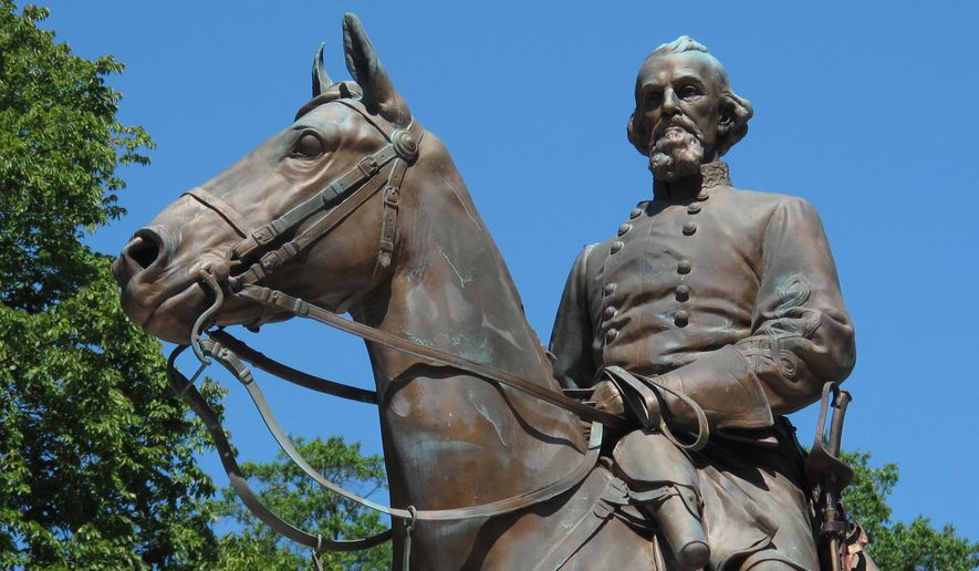 File- In this Aug. 18, 2017, photo, a statue of Confederate Gen. Nathan Bedford Forrest sits in a park in Memphis, Tenn. A city council in Tennessee has voted to sell two city parks where two Confederate statues are located and crews have begun work to remove one of them. The Commercial Appeal reports Memphis Mayor Jim Strickland said in a tweet Wednesday, Dec. 20, 2017, that the parks were sold and that work underway there complies with state law. The city council unanimously approved the sale Wednesday to a private entity.  (AP Photo/Adrian Sainz, File)