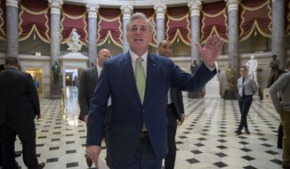House Majority Leader Kevin McCarthy, R-Calif., walks through Statuary Hall for final passage of the Republican tax reform bill, at the Capitol in Washington, Tuesday, Dec. 19, 2017. Republicans muscled the most sweeping rewrite of the nation's tax laws in more than three decades through the House. In a last-minute glitch, however, Democrats said three provisions in the bill, including one that would allow parents to use college savings accounts for home-schooling expenses for young children, violate Senate budget rules. McCarthy said the House would vote on the package again on Wednesday. (AP Photo/J. Scott Applewhite)