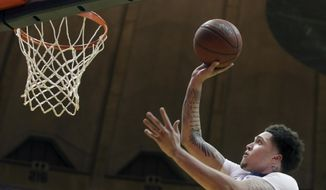 West Virginia forward Teddy Allen drives to the basket during the second half of the team's NCAA college basketball game against Coppin State on Wednesday, Dec. 20, 2017, in Morgantown, W.Va. (AP Photo/Raymond Thompson)