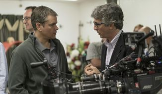 """This image released by Paramount Pictures shows actor Matt Damon, left, on the set of """"Downsizing,"""" with director Alexander Payne. (Merie W. Wallace/Paramount Pictures via AP)"""
