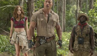 "This image released by Sony Pictures shows Karen Gillan, from left, Dwayne Johnson and Kevin Hart in ""Jumanji: Welcome to the Jungle."" (Frank Masi/Sony Pictures via AP)"