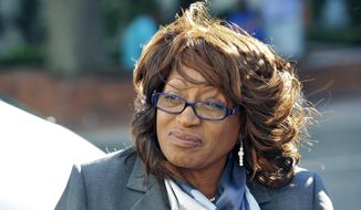 FILE - In this May 5, 2017, file photo, former U.S. Rep. Corrine Brown walks to the federal courthouse in Jacksonville, Fla. A federal judge has denied a request by Brown to remain free while she appeals her fraud sentence. U.S. District Court Judge Timothy Corrigan on Wednesday, Dec. 20,  said Brown has failed to raise a substantial question of law or fact in her argument for appeal, so she will have to surrender to the Bureau of Prisons in January.  Brown was sentenced to five years in prison and three years' probation for fraud and lying on her tax returns about a purported charity for poor students she used as a personal slush fund.  (Bob Self/The Florida Times-Union via AP, File)