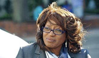 In this May 5, 2017, file photo, former U.S. Rep. Corrine Brown walks to the federal courthouse in Jacksonville, Fla. (Bob Self/The Florida Times-Union via AP, File)