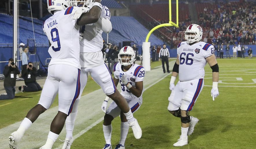 Louisiana Tech wide receiver Teddy Veal (9) celebrates his touchdown reception against Louisiana Tech during the first quarter of the Frisco Bowl NCAA college football game Wednesday, Dec. 20, 2017, in Frisco, Texas. (Andy Jacobsohn/The Dallas Morning News via AP)