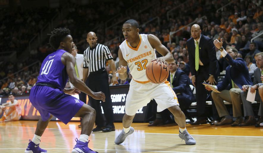 Tennessee guard Chris Darrington (32) is defended by Furman guard Alex Hunter (10) in the first half of an NCAA college basketball game Wednesday, Dec. 20, 2017, in Knoxville, Tenn. (AP Photo/Crystal LoGiudice)