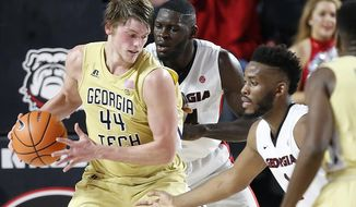 Georgia Tech center Ben Lammers (44) tries to get by Georgia forward Yante Maten (1) and Georgia forward Derek Ogbeide during the first half of an NCAA basketball game, Tuesday, Dec. 19, 2017 in Athens, Ga.  (Joshua L. Jones/Athens Banner-Herald via AP)