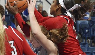 Louisville's Myisha Hines-Allen grabs the ball from Air Force guard Emily Conroe during an NCAA college basketball game at Air Force Academy, Colo., Wednesday, Dec. 20, 2017. Louisville won 62-50. (Jerilee Bennett/The Gazette via AP)