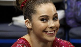 FILE - In this Aug. 17, 2013 file photo McKayla Maroney smiles after competing on the floor exercise during the U.S. women's national gymnastics championships in Hartford, Conn. Maroney says the group that trains U.S. Olympic gymnasts forced her to sign a confidential settlement to keep allegations of sexual abuse by the team's doctor secret. Maroney filed a lawsuit Wednesday, Dec. 20, 2017, in Los Angeles, against the United States Olympic Committee and USA Gymnastics. The suit also seeks damages from Michigan State University, where the team's doctor, Larry Nassar, worked for decades. (AP Photo/Elise Amendola,File) **FILE**