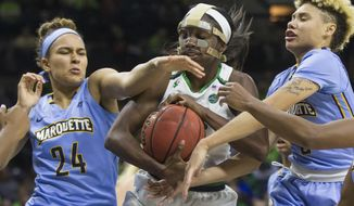 Notre Dame's Jackie Young, center, competes for the ball with Marquette's Selena Lott (24) and Natisha Hiedeman (5) during the first half of an NCAA women's college basketball game Wednesday, Dec. 20, 2017, in South Bend, Ind. (AP Photo/Robert Franklin)