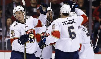 Florida Panthers center Nick Bjugstad (27) celebrates his goal against the Arizona Coyotes with defenseman Ian McCoshen, second from left, defenseman Alexander Petrovic (6) and center Colton Sceviour, right, during the second period of an NHL hockey game, Tuesday, Dec. 19, 2017, in Glendale, Ariz. (AP Photo/Ross D. Franklin)