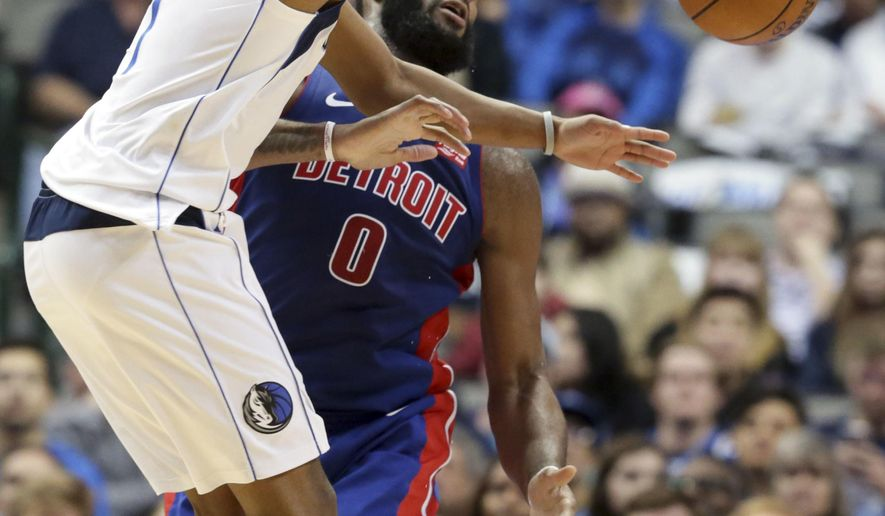Dallas Mavericks guard Dennis Smith Jr. (1) reaches for the ball against Detroit Pistons center Andre Drummond (0) during the first half of an NBA basketball game in Dallas, Wednesday, Dec. 20, 2017. (AP Photo/LM Otero)