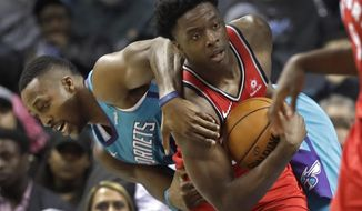 Toronto Raptors' OG Anunoby, right, steals the ball from Charlotte Hornets' Dwight Howard, left, during the second half of an NBA basketball game in Charlotte, N.C., Wednesday, Dec. 20, 2017. (AP Photo/Chuck Burton)
