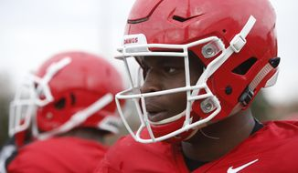 FILE - In this Dec. 18, 2017, file photo, Georgia NCAA college football linebacker Roquan Smith watches a team practice in Athens, Ga. The Rose Bowl's marquee matchup of Georgia safety Roquan Smith, the Butkus Award winner, against Oklahoma's Heisman-winning quarterback Baker Mayfield, is attractive. (Joshua L. Jones/Athens Banner-Herald via AP, File) **FILE**