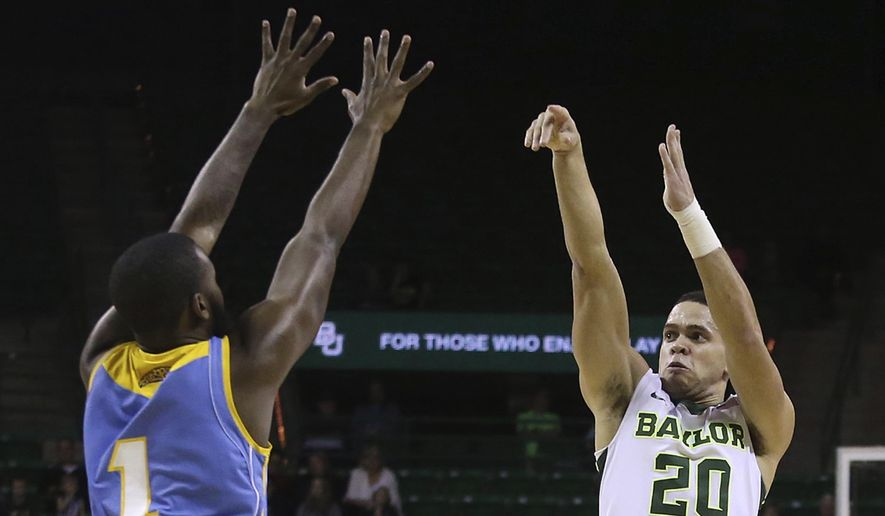 Baylor guard Manu Lecomte (20) shoots a 3-pointer over Southern University guard LaQuentin Collins during the first half of an NCAA college basketball game, Wednesday, Dec. 20, 2017, in Waco, Texas. (AP Photo/Jerry Larson)