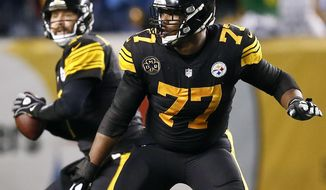 FILE - In this Nov. 16, 2017, file photo, Pittsburgh Steelers offensive tackle Marcus Gilbert (77) blocks as quarterback Ben Roethlisberger (7) looks to pass against the Tennessee Titans during the first half of an NFL football game in Pittsburgh. Gilbert is back from a four-game suspension. (AP Photo/Keith Srakocic, File)