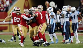San Francisco 49ers kicker Robbie Gould, second from left, is mobbed by teammates after kicking the game-winning field goal during the fourth quarter of an NFL football game against the Tennessee Titans Sunday, Dec. 17, 2017, in Santa Clara, Calif. (AP Photo/John Hefti)