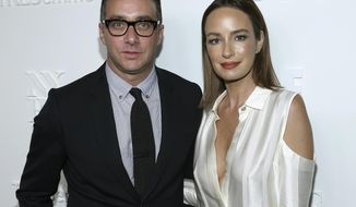 "FILe - In this Sept. 6, 2017 file photo, President of E! Entertainment Adam Stotsky, left, and TV host Catt Sadler attend the ELLE, E! and IMG New York Fashion Week kick-off party in New York. Sadler, a co-host of ""Daily Pop"" on the E! Entertainment network, and said she's leaving after learning that on-air partner Jason Kennedy makes nearly twice as much money as she does. (Photo by Donald Traill/Invision/AP, File)"